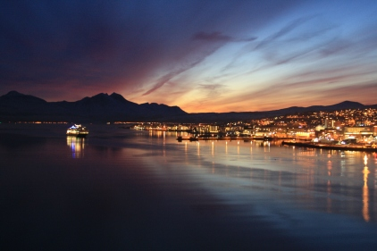 Winter: And the light disappears over Tromsø as the Hurtigruten boat arrives.